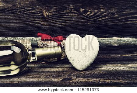 Heart, Gifts And Bottle Of Wine On Table.