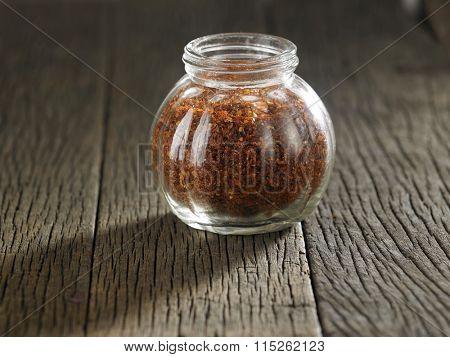 coarse chili powder in a glass container