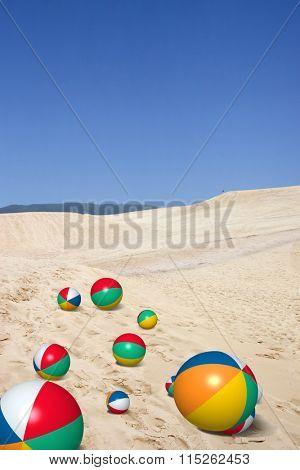 Dunes and Beach balls on Joaquina beach in Florianopolis, Santa Catarina, Brazil
