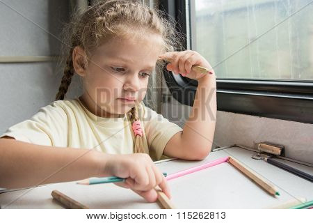 Four-year Girl Playing With Pencils Reserved Seats At A Table In A Train