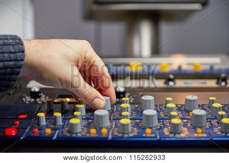 Turning The Knobs On The Mixing Console