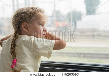 Girl With Anxiety And Sadness Looks Out The Window Of The Train Car