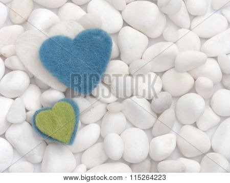 Concept of love, hearts on the white stones