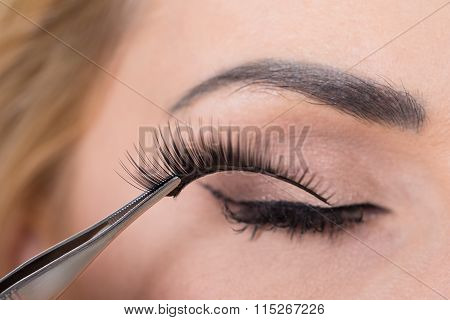 False Eyelashes Being Put On Woman's Eye