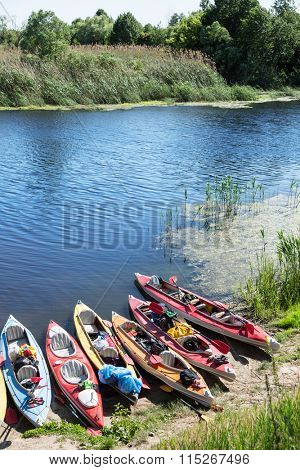 Canoes on a river-bank. Rafting on the Vorskla River.