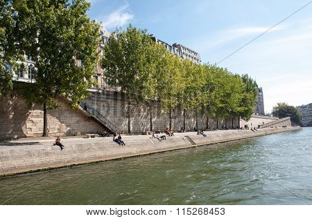 PARIS, FRANCE - SEPTEMBER 9, 2014: People are enjoying their free time on the banks of river Seine in Paris France.