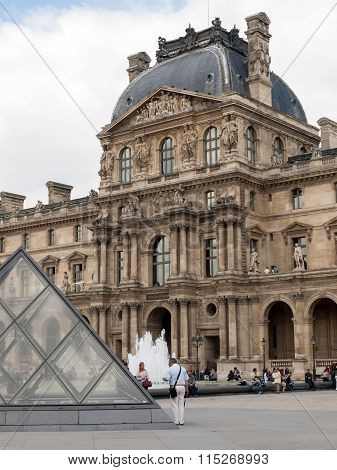 PARIS, FRANCE - SEPTEMBER 11, 2014: Paris - The Louvre . Louvre is one of the biggest Museum in the world receiving more than 8 million visitors each year.