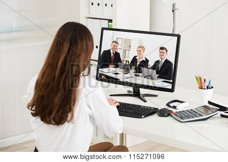 Businesswoman Attending Video Conference On Computer