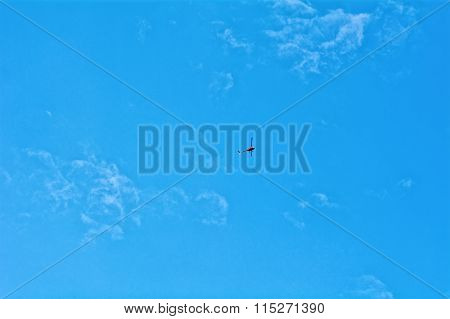 Small Helicopter Hovering On Blue Sky