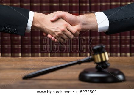 Judge And Client Shaking Hands At Courtroom