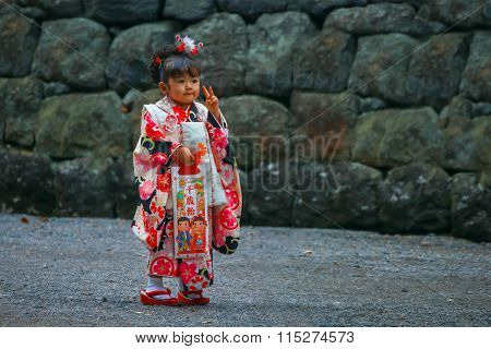 Nikko Japan - November 17 2015: Parents and Children at Toshogu shrine in a Traditional rite of passage and festival day in Japan for 3 and 7-year-old girls and 3 and 5-year-old boys