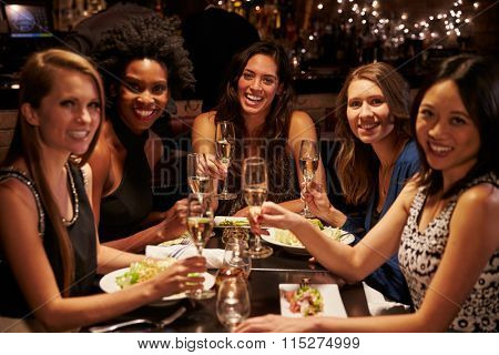 Group Of Female Friends Enjoying Meal In Restaurant