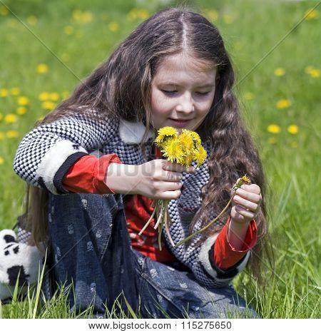 girl with yellow dandelions