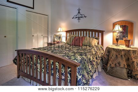 simple bedroom with queen size bed and closets