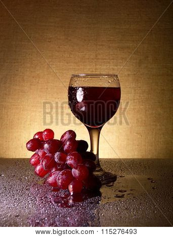 Glass Wine And Bunch Grapes