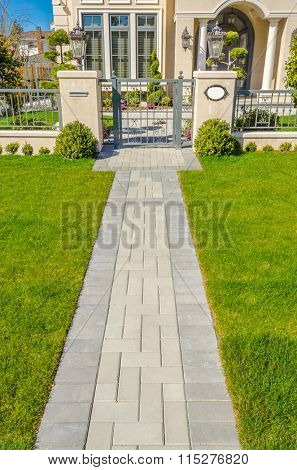 A nice entrance of a luxury house over outdoor landscape
