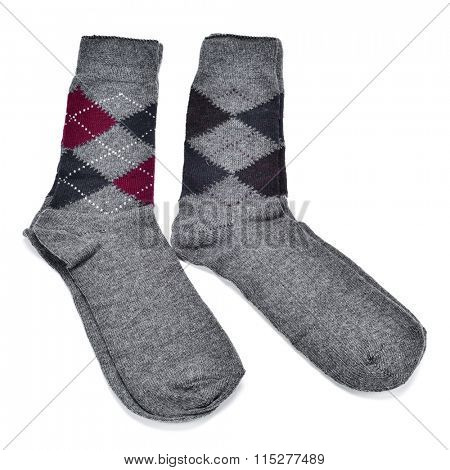 two pairs of argyle patterned socks in different colors on a white background