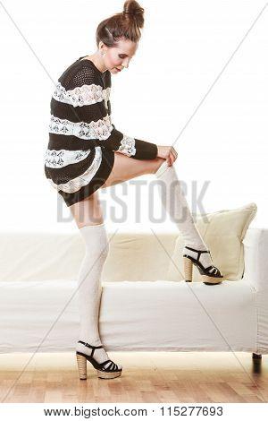 Fashionable Girl Puts On Woolen Stockings