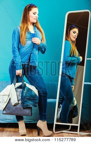 Fashion Woman Wearing Blue Denim In Front Of Mirror