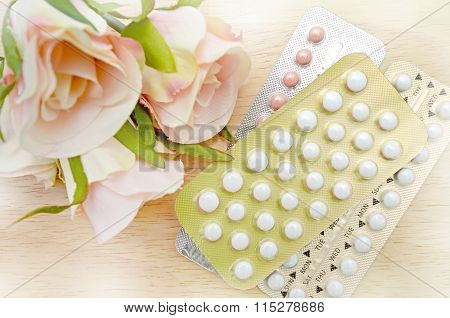 Oral Contraceptive Pill Strips On Pine Wood Table.
