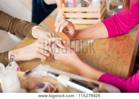 Woman Getting Her Nails Filed
