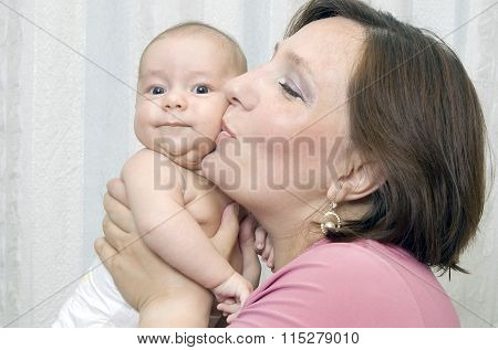 Mother kisses the kid