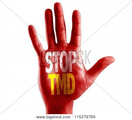Stop TMD (Temporomandibular joint dysfunction) written on hand isolated on white background