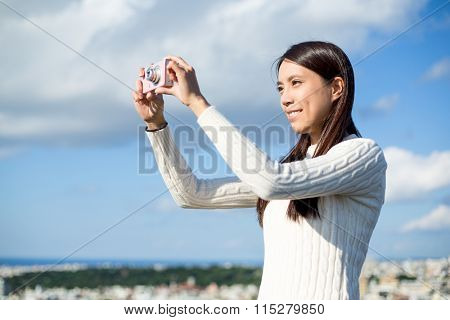 Young Woman taking photo at outdoor
