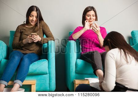 Women Relaxing At A Nail Spa