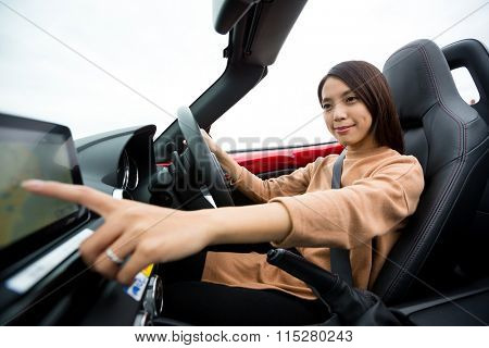 Woman checking the direction on car GPS system