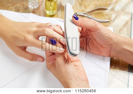 emery polish sandpaper woman nails in Nail Salon