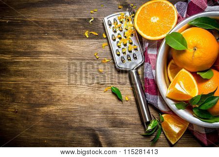 Cup With Fresh Oranges, Zest And Grater On Fabric.