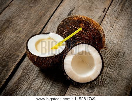 Fresh Cocktail In Coconut Cup On Wooden Background.