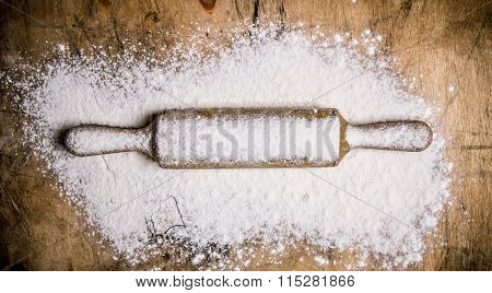 The Rolling Pin With Flour. On Wooden Table.