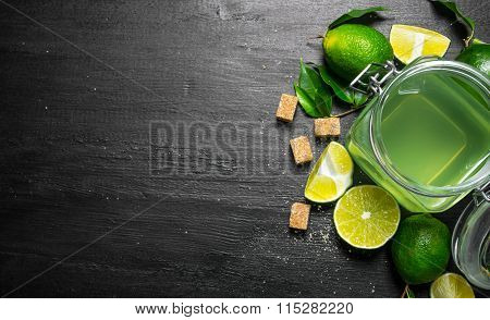 Lime Background. The Juice From The Limes, Sugar And Slices Of Lime.