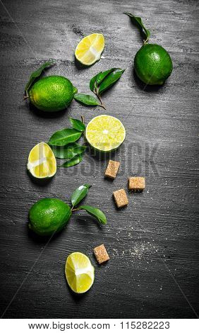 Lime Background. Limes, Sugar And Leaves.