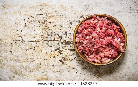 Fresh Raw Minced Meat In A Wooden Bowl.