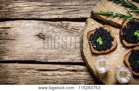 Sandwiches With Black Caviar And Vodka.