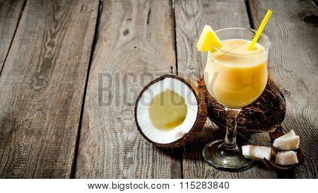 Fresh Cocktail In A Glass With Coconut On Wooden Table. Free Space For Text.