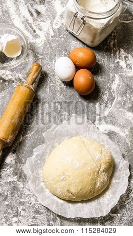 The Dough With The Ingredients And A Rolling Pin.