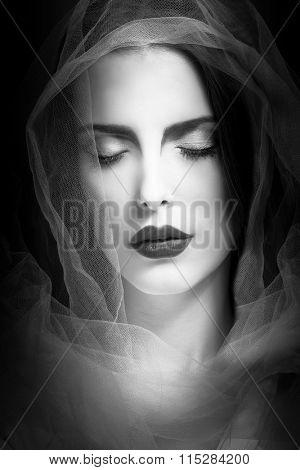 mystical woman beauty portrait with veil, studio shot, closeup, black and white