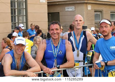 Smiling Triathlon Team After The Finnish Of The Triathlon Event