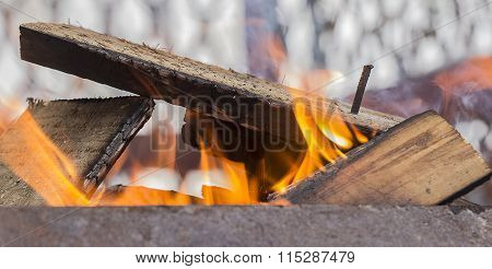 Firewood Heating Up In The Grill