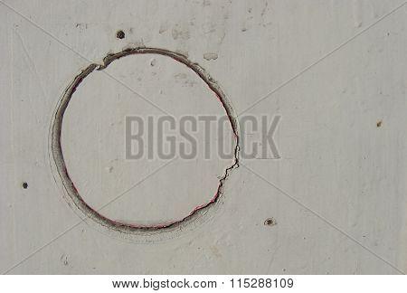 Circular Crack Damage On White Grungy Panel
