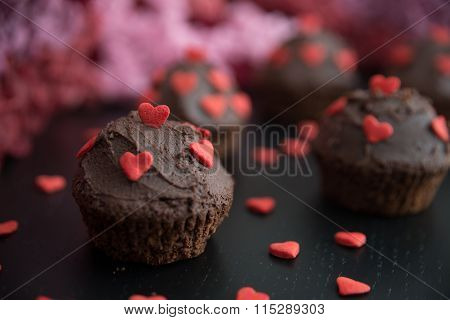 Chocolate Cupcake with red sugar hearts for valentines day