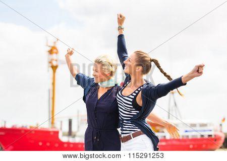 Woman enjoying vacation at German north sea ship pier in harbor
