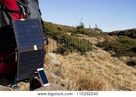 The solar panel on the backpack