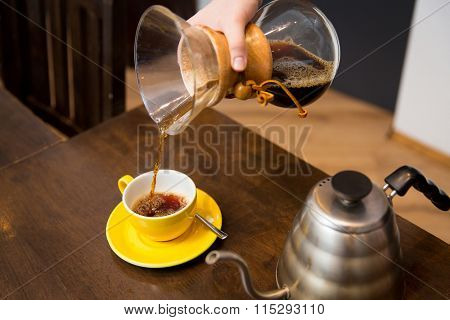 close up of woman with coffeemaker