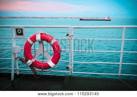 The image of a life buoy on a ship