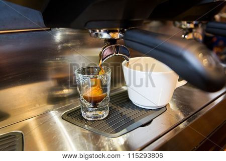 close up of espresso machine making coffee
